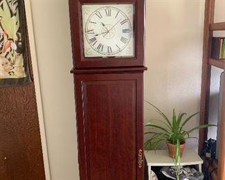 Clock storage cabinet