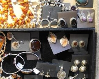 50% off sterling silver jewelry, many pieces with amber or other natural stones. Some bracelets are gold vermeil over sterling silver.