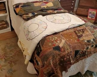 Adjustable electric twin bed and antique quilts