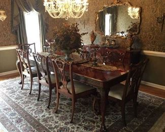 "Formal Cherry Dining Room Table that seats 10; the table has 2 captains chairs w/arms (4 of the 10 chairs are coordinating). The table is pictured with 2 leafs and measures 9 Feet  (each leaf measures 18""). Price for table and chairs - 2,900.00"