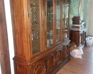 Drexel French Countryside Collection. Large china cabinet, buffet,  dining table with three extension leaves , six side chairs & two arm chairs. All in good condition!