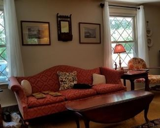living room, formal sofa, coffee table, side chairs, signed artwork, mirrors, area rugs