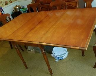 antique, drop-leaf dining room table, with 6 upholstered chairs and pads