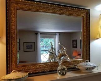 large, gilded, antique mirror