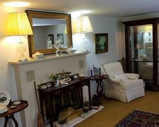living room, formal sofa, coffee table, side chairs, signed artwork, mirrors, area rugs, hall table, side tables, large curio cabinet
