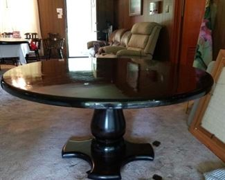"""Dining table is 60"""" diameter and sold wood. It has 5 matching Dining Chairs AND a Lazy Susan"""