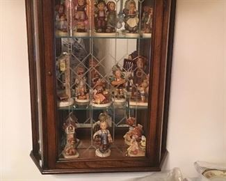 Hummels and wall mounted curio cabinet