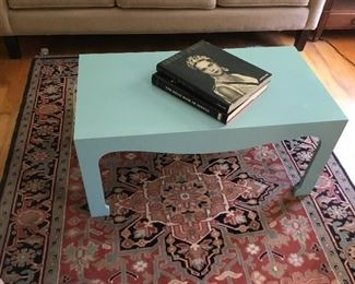 Designer coffee table and oriental rug