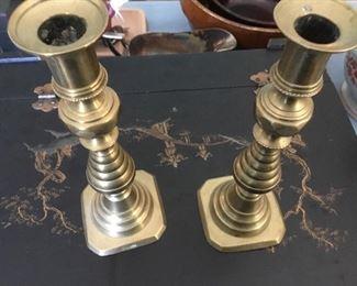 Pair of antique push up brass candlesticks