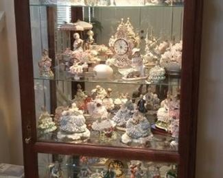 Full curio cabinet..Lladros, Dresden figurines and collectibles