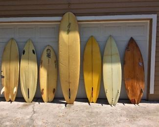 "Locally Shaped Surfboards. Incline, 5' 10"". CW, 5' 9"". CW, 5' 2"". Robert Strickland, 8'. MTB, 6'. Incline 6'."