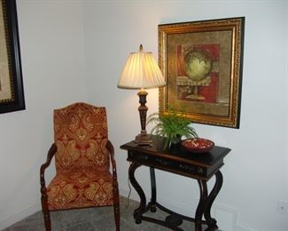 Upholstered arm chair and table