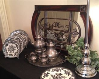 Mirror; pewter tea set; black and white plates; one of two silver lamps