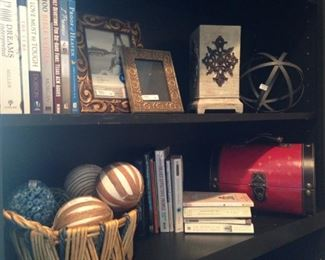Books, frames, and decorative items