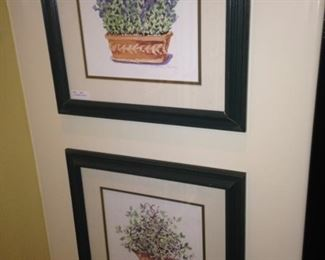 Two of three companion framed and matted floral art