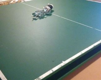 Tournament size ping pong table glides over the pool table.