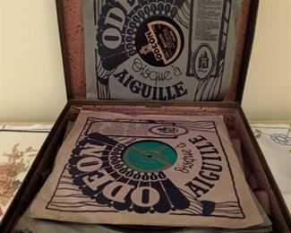 Vintage portable phonograph with records