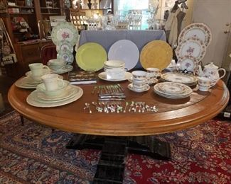 Large Round Table and china/dish collection including Vietri from Kimberly's Closeout. Several cocktail serving pieces of flatware. Crystal glasses.