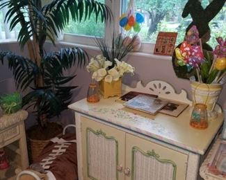 2 of 2 white wicker hand painted cabinets, artificial tree, pillow pet, and other décor.
