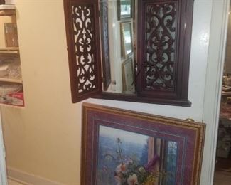 Heavy hanging mirror with wooden lattice-type front, framed art.