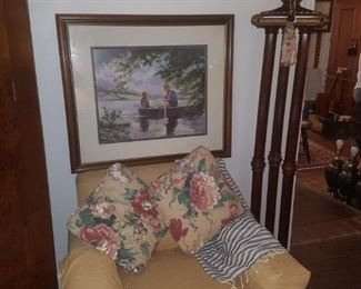 Beautiful floor lamp, framed art, and accent chair/pillows