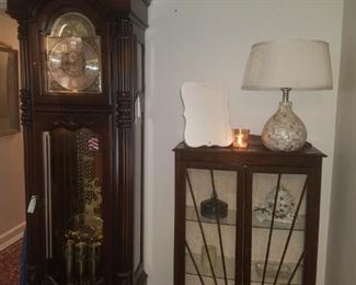 Howard Miller grandfather clock from the presidential series, Ronald Reagan. English imported small china/curio cabinet, table lamp, & more.