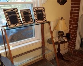 Antique display cabinet from the family beauty shop, frames (from Kimberly's closeout), accent table, table lamp, & more.