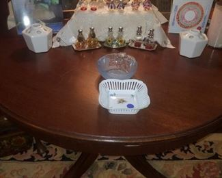 Round, mahogany breakfast table, hand blown glass salt/pepper collection, books, frames, & more.