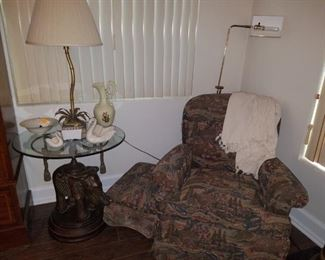 Elephant, metal base with glass top table. Palm table lamp. Accent chair and ottoman, Lenox swans, & other décor