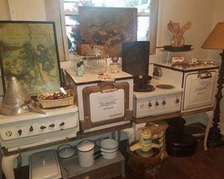 Hotpoint electric enamel stoves, enamelware server/warmer, wooden ice cream churn, iron skillet, art, cotton bale, & more.
