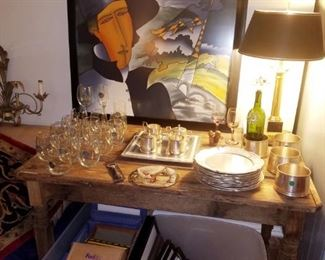 Contemporary framed art, table lamp, primitive table, frames, pewter plates, pewter wine coasters, glasses, & more.