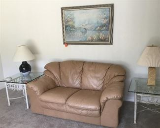Tan leather loveseat / 2 metal and glass side table / lamps
