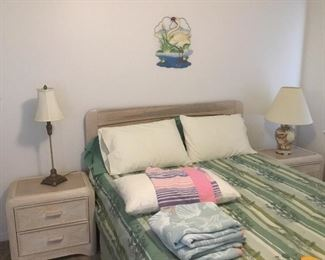 Queen size bed with two night chests
