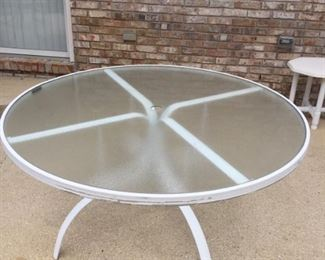 White glass top table round and no chairs