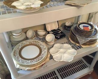 Lots of set of porcelain dishes, chargers, blue cobalt set, some Limoges, oyster plates...