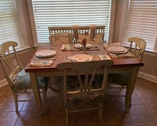 This table was sold. Purchase in New York at Domain Furniture like new as you see it sit four people the oak wood open up and spin around to it sit 6 people. I have the extra chair but not in the picture.
