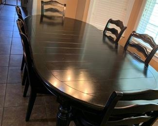 Black oak Wooden kitchen table with a wide top in mint condition paid over $2000 for it. Also, come with 4 matching stool for the kitchen counter.