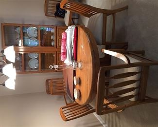 Oak dining room set.  Table 4 side chairs, 2 captains chairs and china cabinet