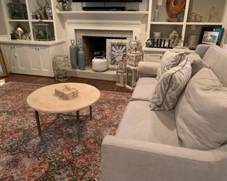 Round stone coffee table from Outrageous Interiors