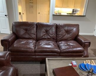 Gorgeous brown leather loveseat and sofa available