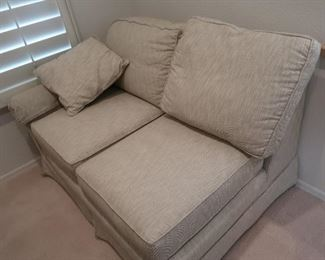 """""""L"""" shaped couch.  One piece in the office, one-piece in the living room"""