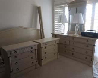 Fantastic bedroom set includes a four-poster bed, 2 nightstands, dresser with mirror, and armoire.