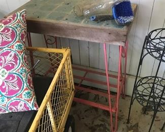 Pink metal table with tile top