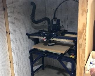 """CNC router is a 3 axis ShopBot Inc. """"PRT"""" with a cutting area of 24"""" x 32"""". The router motor is a 110V 3.25hp Porter cable model 75182. The stepping motors drivers have been updated for better performance. It is on a metal stand and includes a Dell Inspiration laptop computer, computer and controller console, dust and noise enclosure and Vectric V-Carve Pro 8.5 design software.$3500"""