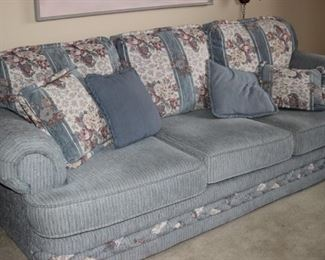 Blue fabric couch.
