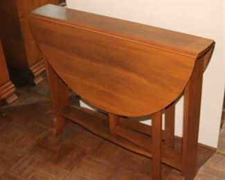 Very narrow drop leaf table.