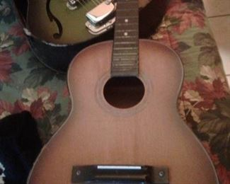 Acoustic guitar by Prestige. Needs strings