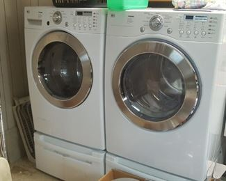 LG Tromm Washer and Dryer with pedestals