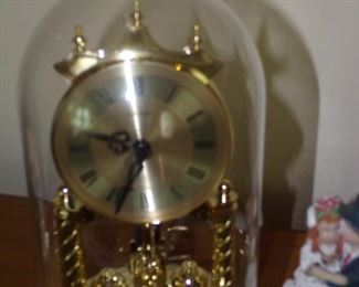 Brass clock under dome $45.00