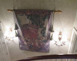 huge hanging tapestry over stairway